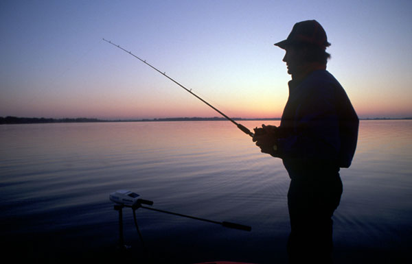 A fisherman symbolizes the use of social media to attract visitors to your website