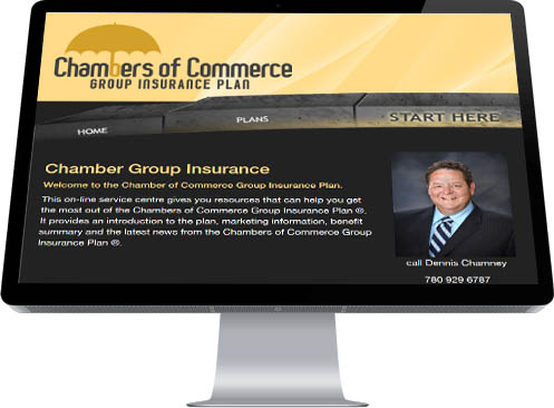 A smiling insurance agent in a suit and tie provides a warm graphic for the Home Page of Chamber Group Insurance made by INM of Edmonton