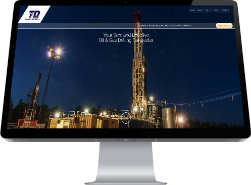 An immaculate, towering, btightly illuminated drilling rig set against a dark sky is the compelling image used by Edmonon's Industrial NetMedia as the Home Page image of their website