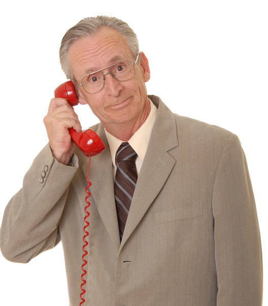 The man on the phone is calling for a free consultation from INM regarding a social media marketing package