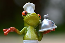 A Frog Chef with a serving tray typifies the thought of eating frogs.