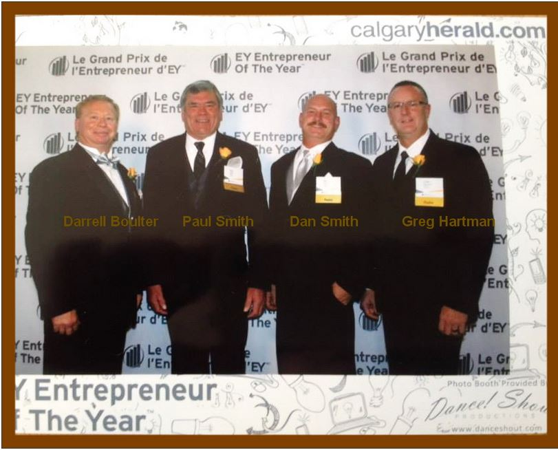 Four beaming men in suits and ties make a great addition to the Photo Gallery on the Ride Inc website developed by Industrial NetMedia of Alberta