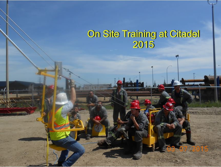 Oil workers in rig gear watch a coworker rapidly descend towards them in this image from the Ride Inc photo gallery developed for them by Alberta's website design professionals,  INM