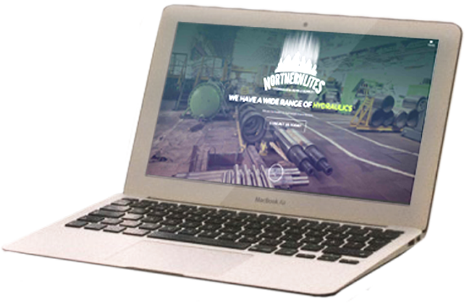 A laptop with an image of a website home page designed by INM of Edmonton
